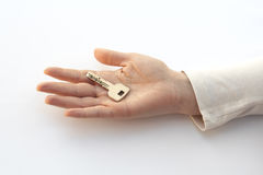 Key on the hand. Over white background royalty free stock photos