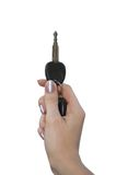 Key in a hand. Isolate on white Stock Images
