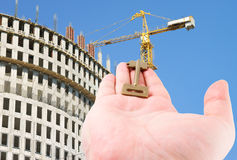 Key in hand on building background Stock Image