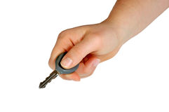 Key in Hand  (with clipping path). A key in a young woman's hand Royalty Free Stock Photos