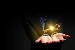 Key in hand. Close up image of business person holding shining key Stock Images