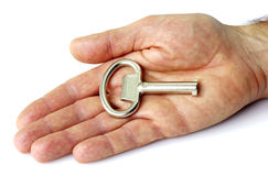 Key in hand Stock Photos