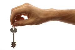 Key in the hand isolated on white. The hand of man holds the key on a white background royalty free stock images