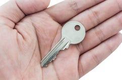 Key on hand isolated on white background. Key on hand isolated on a white background Royalty Free Stock Photo