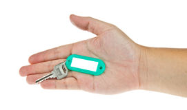 Key in hand with label Stock Images