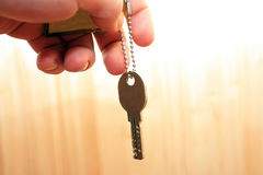 Key in a hand of the man Royalty Free Stock Photography