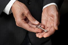 Key Hand Success Superannuation. A businessman holding a gold key in his hands Stock Images