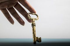 Key in hand touch gold life Stock Photos