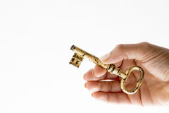 Key in hand unlock. Studio photography key in hand gold shining design Stock Photo
