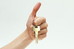 Key in hand  on white background Stock Images