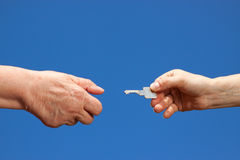 Key handover between young and old Royalty Free Stock Images