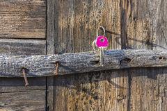 Key hanging on old rustic nail. Key hanging on wooden wall Royalty Free Stock Photography