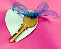 Key, Heart and Bow Stock Images