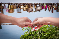 Key of heart love with hand woman and man Stock Photography