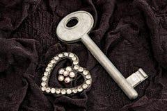 Key and heart of rhinestones Stock Photos