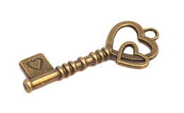 Key with heart shape. Isolated on white background Royalty Free Stock Photos