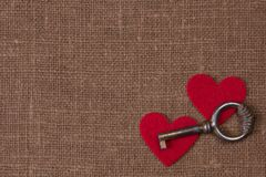 Key and hearts Royalty Free Stock Photos