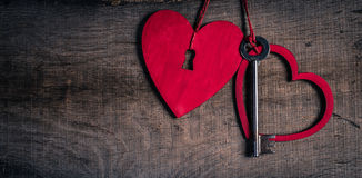 Key with the hearts as a symbol of love. Heart with a keyhole. royalty free stock photos