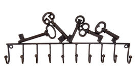 Key Holder Rack. Old cast iron key holder rack over white background Royalty Free Stock Photos