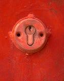 Key hole. Red key-hole Royalty Free Stock Photography