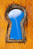 Key hole with blue sky Royalty Free Stock Image