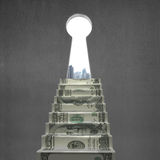 Key hole with money stairs and city view Royalty Free Stock Photo