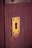 Key hole in old wooden door Stock Photo