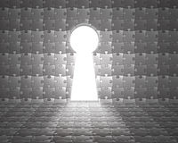 Key hole shape door on puzzles wall with bright lighting outside Royalty Free Stock Images