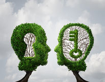 Key Hole Solution Partnership. And key opportunity business concept as two trees shaped as a human head with a key and keyhole shapes as a collaboration success Royalty Free Stock Photo