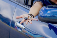Key on hole. Transportation and ownership concept - man with car key stock photo