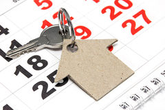 Key, home and calenda: busines- still life. Key and house from a paper on a calendar background Stock Images