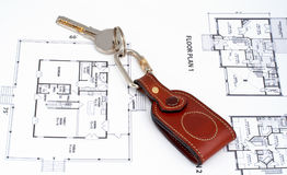 Key on home plan Royalty Free Stock Photos