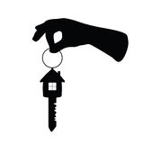 Key with house on it and arm vector Stock Photos