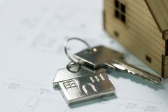 Key with house plan Royalty Free Stock Images