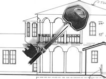 Key on house plans. Old fasion key on plans Royalty Free Stock Photography