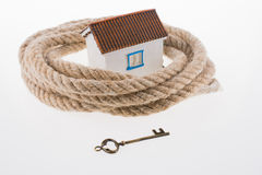 Key, house and rope Royalty Free Stock Photo