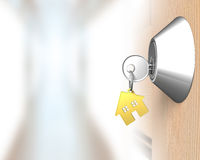 Key with house shape key-ring and door lock Stock Images