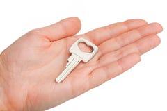 Key on a human palm Stock Photo