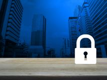 Business security concept. Key icon on wooden table over modern office city tower background, Business security concept stock images