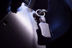 Key in the ignition cars with leather keychain blur close-up Royalty Free Stock Image