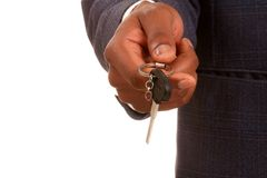 Key. Image of a businessman with a key with studio lighting Stock Photography