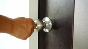 The key is inserted into the keyhole of the door of the house and open.