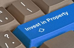 Key for investment in property. Keyboard with key for investment in property royalty free stock photography
