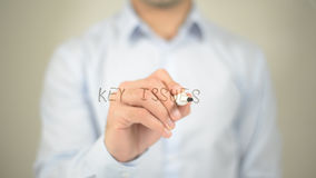 Key Issues , man writing on transparent screen Stock Photo