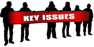 KEY ISSUES on red banner held by people silhouettes at rally. Royalty Free Stock Image