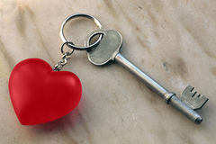 Key and key chain with heart Royalty Free Stock Images