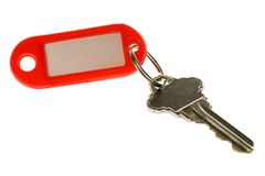 Key with key tag. Isolated on white background Stock Photos