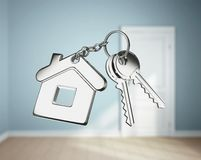 Key with keychain. On blue rooms Royalty Free Stock Image