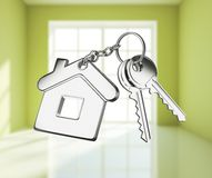 Key with keychain on white rooms. Key with keychain on green rooms Stock Image
