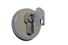 Key in keyhole. An isolated keyhole stock image